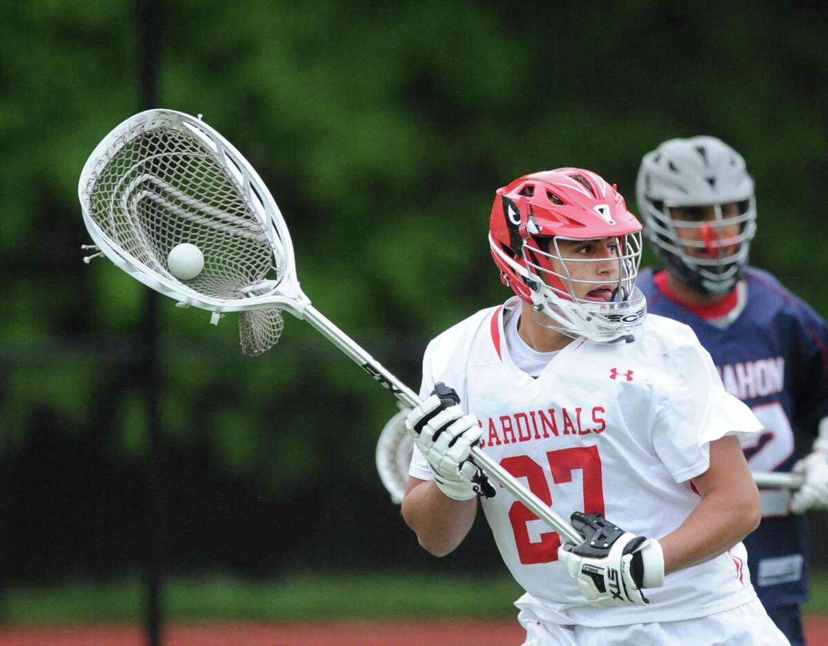 Greenwich goalie Andrew Triscari looks to pass after making a first-quarter stop against Brien McMahon on May 9. Triscari, who recently concluded his senior season, received Academic All-American accolades. He was also named as an FCIAC Scholar Athlete.