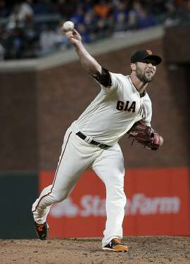 San Francisco Giants pitcher Hunter Strickland throws against the Kansas City Royals during a baseball game in San Francisco, Tuesday, June 13, 2017. (AP Photo/Jeff Chiu)