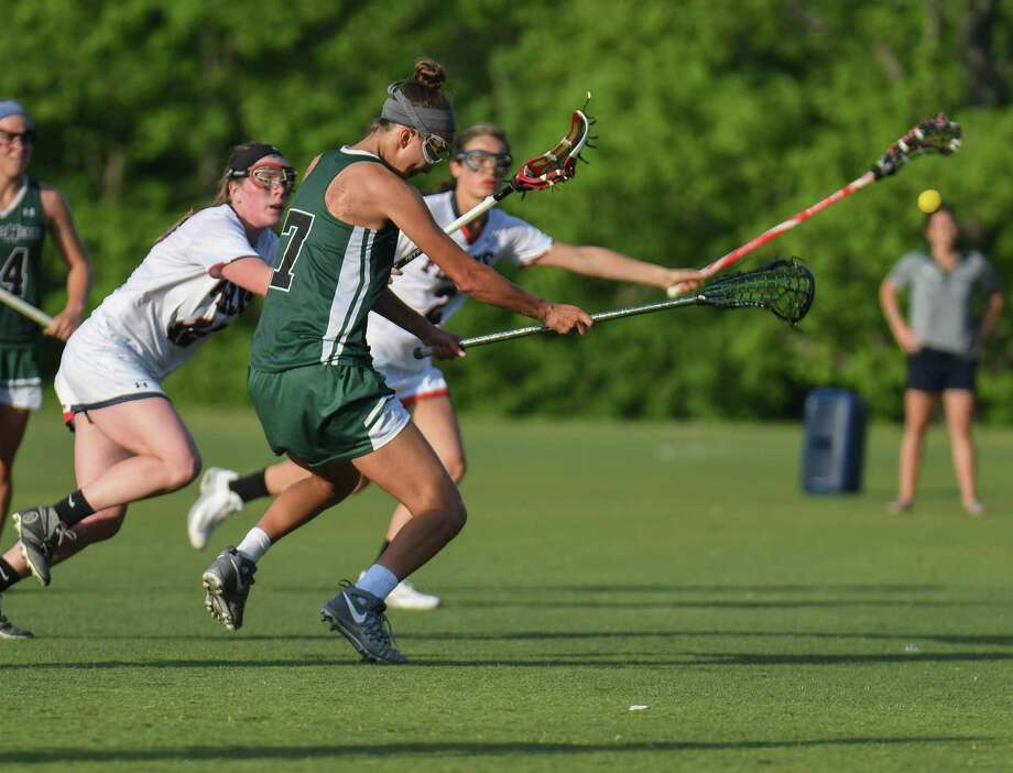 Grace Paletta (7) of Sacred Heart Greenwich shoots during the FAA Girls Championship game against Greens Farms at Sacred Heart Greenwich on May 19. Paletta, Sacred Heart's senior captain, was named to the U.S. Lacrosse Connecticut All-America Lacrosse Team. The All-America Team includes 21 public and private school players from the state. Photo: Gregory Vasil / For Hearst Connecticut Media / Connecticut Post Freelance