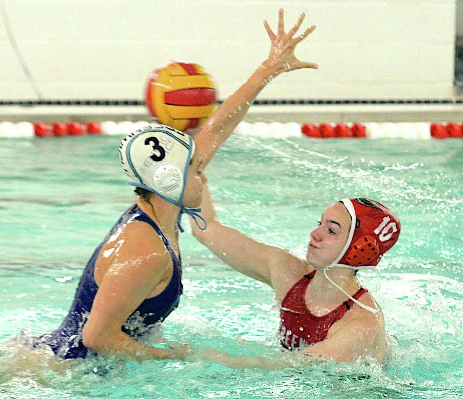 Annie Robinson of Greenwich High School, right, looks to pass the ball while being defended by Ally Furano of Greenwich Aquatics during a game at the Greenwich High School Girls Water Polo Tournament on May 12. Robinson was named to the national team. Photo: Susan Carlson / Contributed Photo / Greenwich Time Contributed