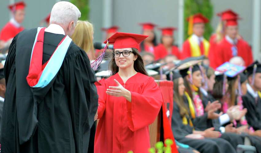 Lucia Arico receives her diploma from David Edling, Headmaster of Fairfield Warde High School, as the Class of 2017 celebrate their Commencement Exercises at the school in Fairfield, Conn., on Thursday, June 15, 2017.