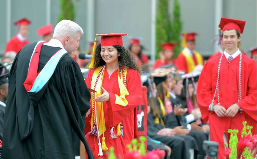 Sarah Assouel receives her diploma from David Edling, Headmaster of Fairfield Warde High School, as the Class of 2017 celebrate their Commencement Exercises at the school in Fairfield, Conn., on Thursday, June 15, 2017.
