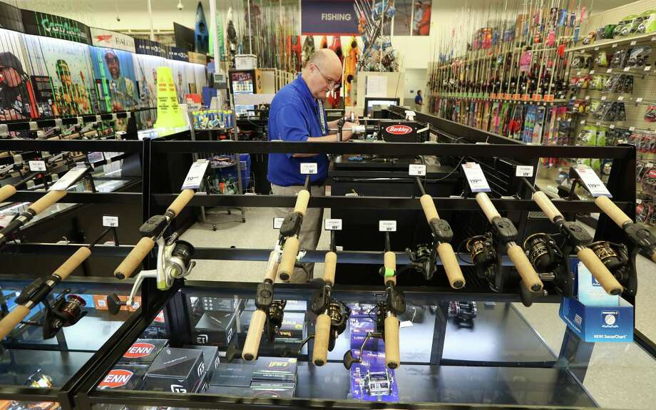 Academy Sports & Outdoors, 9734 Katy Freeway at Bunker Hill, Team Member David Monk re-spools fishline Thursday, June 1, 2017, in Houston. Academy Sports & Outdoors, a sports, outdoor and lifestyle retailer with more than 230 stores in 16 states, is one of Houston's largest private companies. ( Steve Gonzales  / Houston Chronicle ) Photo: Steve Gonzales, Staff / © 2017 Houston Chronicle