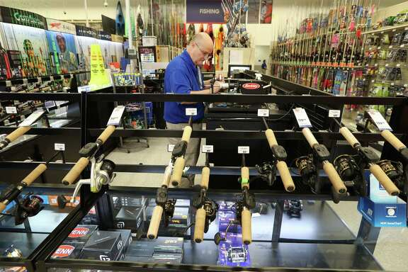 Academy Sports & Outdoors, 9734 Katy Freeway at Bunker Hill, Team Member David Monk re-spools fishline Thursday, June 1, 2017, in Houston. Academy Sports & Outdoors, a sports, outdoor and lifestyle retailer with more than 230 stores in 16 states, is one of Houston's largest private companies. ( Steve Gonzales  / Houston Chronicle )