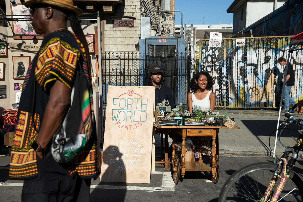 Nathan Goodrich and Brittany Veal (right) sell their brand of planters, Forth World Planters, as vendors during the Oakland First Fridays street festival in Oakland, Calif., on Friday, June 2, 2017. They upcycle discarded products and turn them into sustainable planters for succulents. First Fridays is an art, music, food and community festival that takes place every first Friday of the month, weather permitting. Telegraph Avenue is closed to traffic between West Grand Avenue and 27th Street for the festivities.