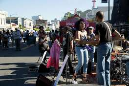 The band Phat Luv performs for attendees of the Oakland First Fridays street festival in Oakland, Calif., on Friday, June 2, 2017. The art, music, food and community festival takes place every first Friday of the month, weather permitting. Telegraph Avenue is closed to traffic between West Grand Avenue and 27th Street for the festivities.