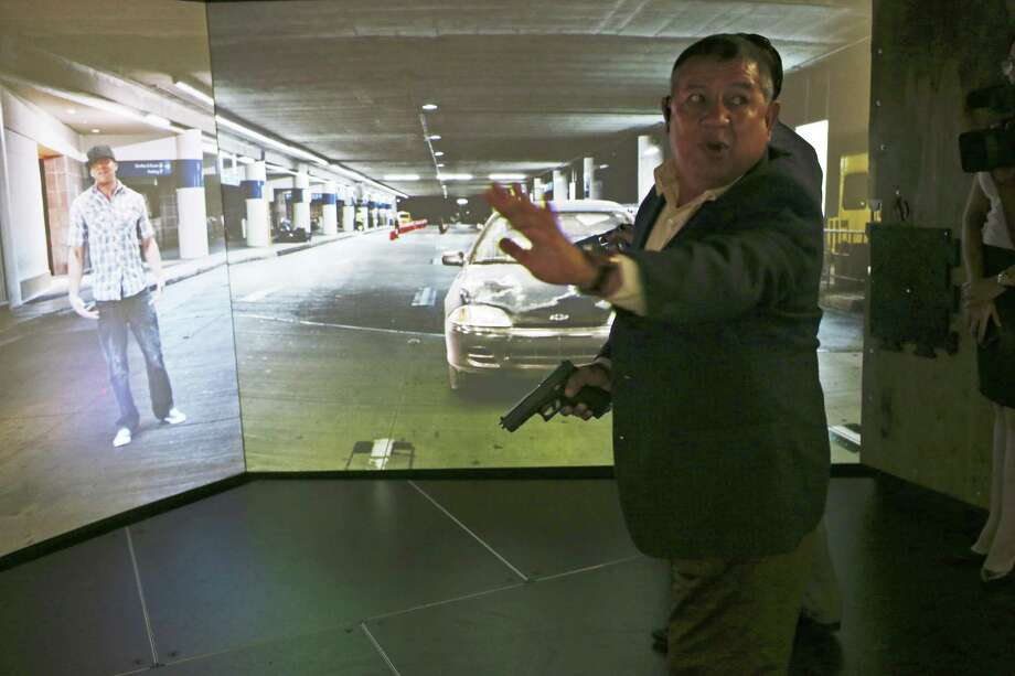 Col. Miguel Angel Nophal Balderas, from the Mexican state of Puebla, tries out a simulator at the Alamo Area Council of Governments Regional Law Enforcement Academy, Thursday, June 15, 2017. Police training instructors from Mexico were at the academy learning about U.S. police training tactics. Photo: JERRY LARA / San Antonio Express-News / © 2017 San Antonio Express-News