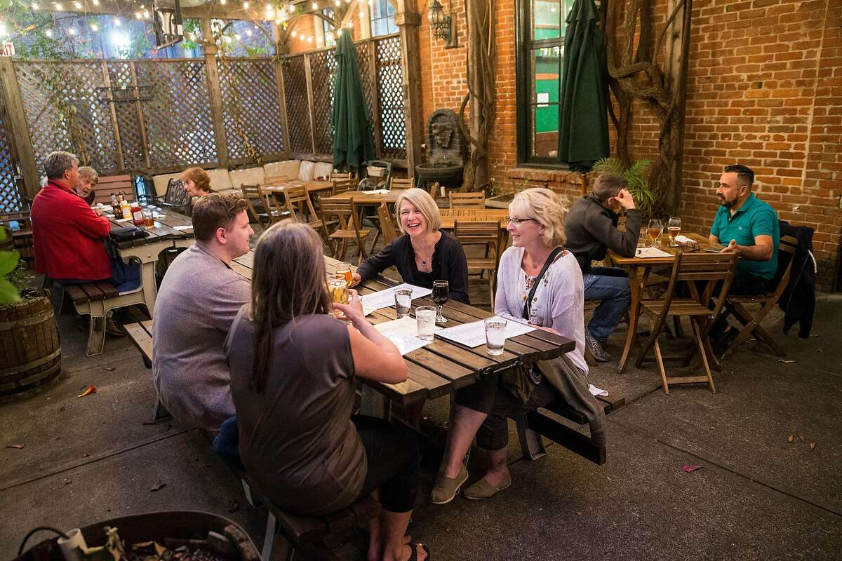Visitors to Pacific Coast Brewing enjoy their outdoor backyard beer garden in Oakland, Calif., on Friday, June 2, 2017. The brewery, restaurant and bar has over 20 beers on tap including both their own brews and guest beers.