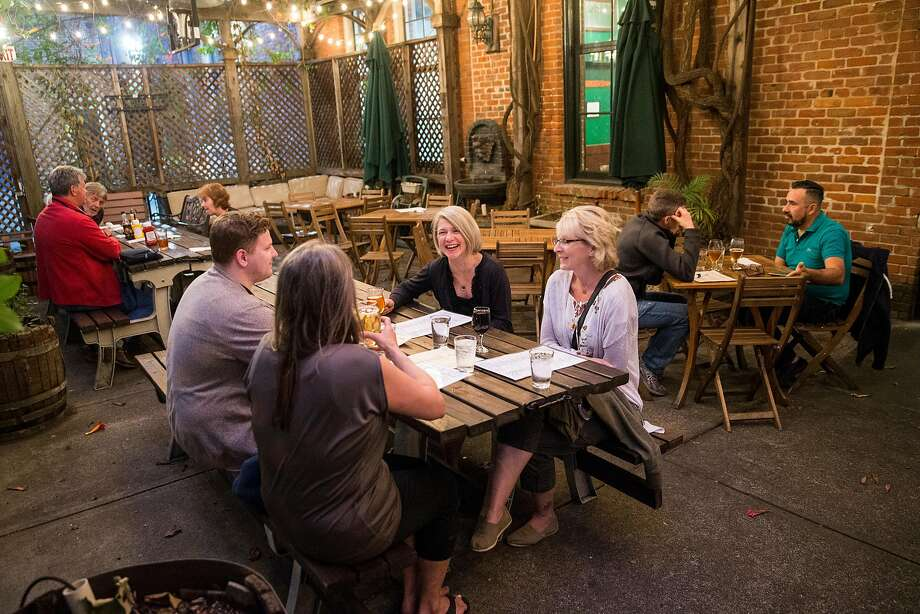 Visitors to Pacific Coast Brewing enjoy their outdoor backyard beer garden in Oakland, Calif., on Friday, June 2, 2017. The brewery, restaurant and bar has over 20 beers on tap including both their own brews and guest beers. Photo: Laura Morton, Special To The Chronicle