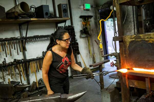 Blacksmithing instructor Celeste Flores works in the blacksmith shop at The Crucible, a nonprofit industrial arts education organization, in Oakland, Calif., on Tuesday, June 6, 2017. The Crucible offers over 20 areas of study with departments such as blacksmithing, glass blowing, woodworking, welding and many more.