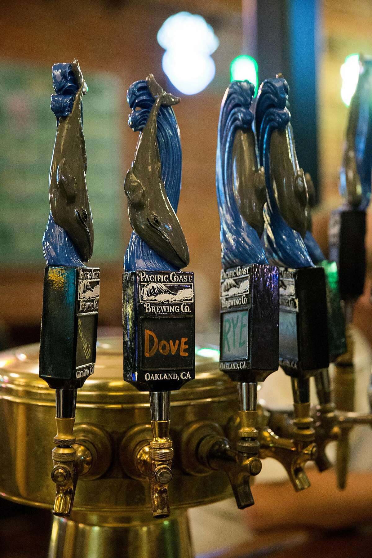 Some of the beers on tap are seen at Pacific Coast Brewing in Oakland, Calif., on Friday, June 2, 2017. The brewery, restaurant and bar has over 20 beers on tap including both their own brews and guest beers.
