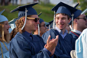 Graduates Casey Wheeler and Thomas Westgate at the Oxford High School commencement ceremony in Oxford, Conn. on Thursday, June 15, 2017.