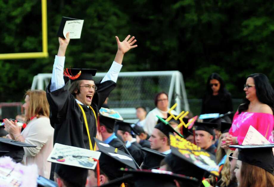 Graduate James Peck celebrates getting his diploma during Shelton High School's Class of 2017 Commencement Exercises in Shelton, Conn., on Thursday June 15, 2017. Photo: Christian Abraham, Hearst Connecticut Media / Connecticut Post