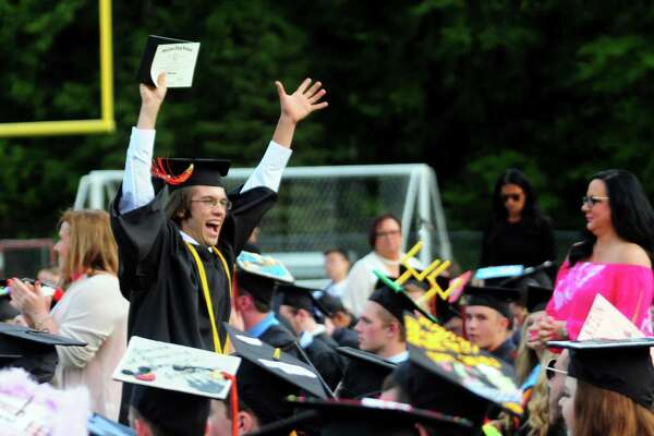 Graduate James Peck celebrates getting his diploma during Shelton High School's Class of 2017 Commencement Exercises in Shelton, Conn., on Thursday June 15, 2017.