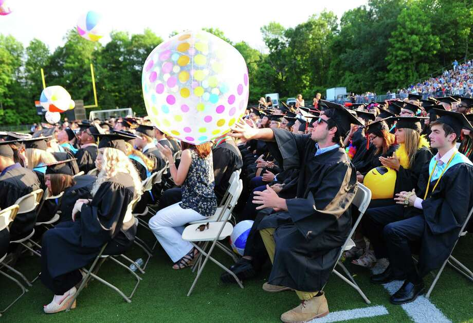 Graduate Tom Monahan sends a large beach ball into the air during Shelton High School's Class of 2017 Commencement Exercises in Shelton, Conn., on Thursday June 15, 2017. Photo: Christian Abraham, Hearst Connecticut Media / Connecticut Post