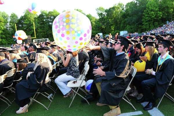 Graduate Tom Monahan sends a large beach ball into the air during Shelton High School's Class of 2017 Commencement Exercises in Shelton, Conn., on Thursday June 15, 2017.