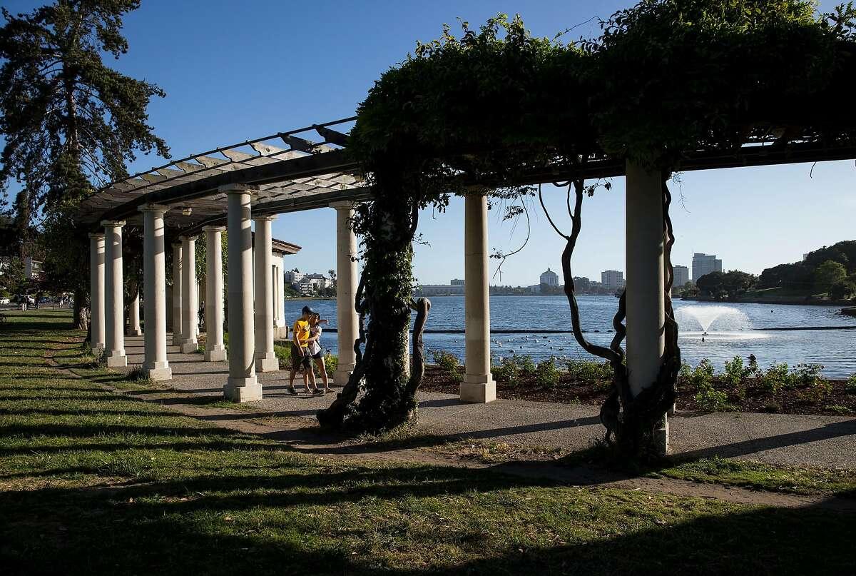 Visitors to Lake Merritt walk along it's shores in Oakland, Calif., on Sunday, June 4, 2017.