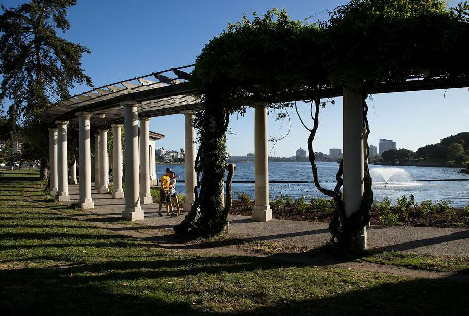 Visitors to Lake Merritt walk along it's shores in Oakland, Calif., on Sunday, June 4, 2017. Photo: Laura Morton / Special To The Chronicle
