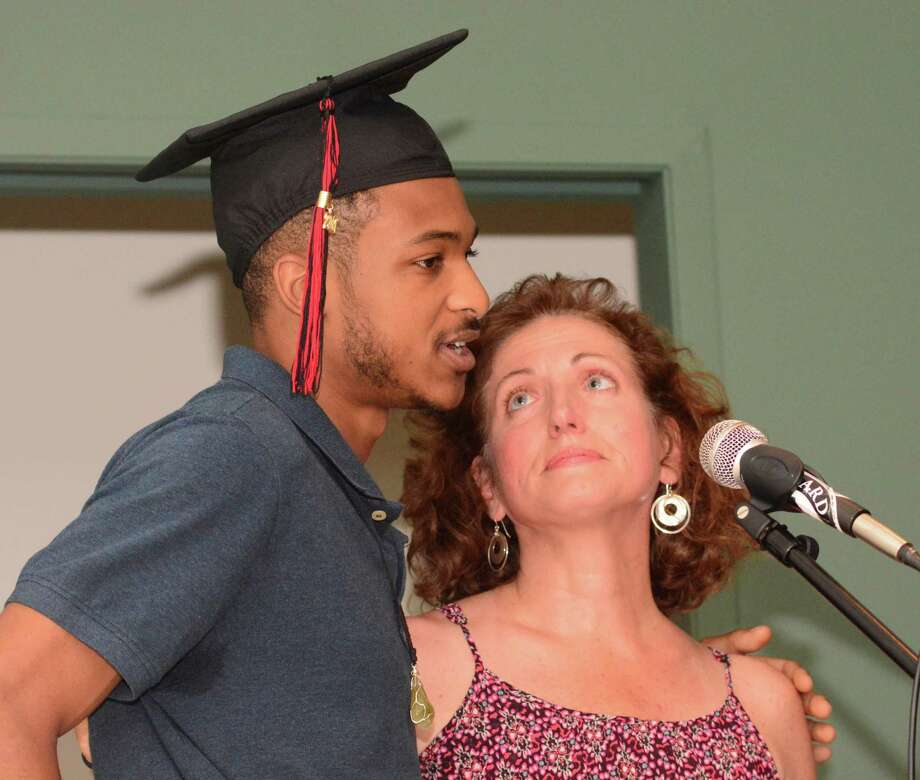 Marcus Spruill gets an support from his teacher, Laura Blake, during The Alternative Center for Excellence, ACE, graduation that took place at Western Connecticut State University on Thursday June 15, 2017. Photo: Lisa Weir, For Hearst Connecticut Media / The News-Times Freelance