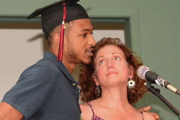 Marcus Spruill gets an support from his teacher, Laura Blake, during The Alternative Center for Excellence, ACE, graduation that took place at Western Connecticut State University on Thursday June 15, 2017.