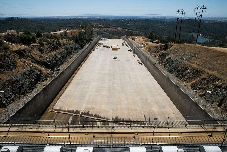 The upper 1,000 feet of the main 3,000-foot-long chute at the Oroville Dame is being patched and waterproofed, then rebuilt next summer because there just isn't time to do it this year. Photo: Mason Trinca, Special To The Chronicle