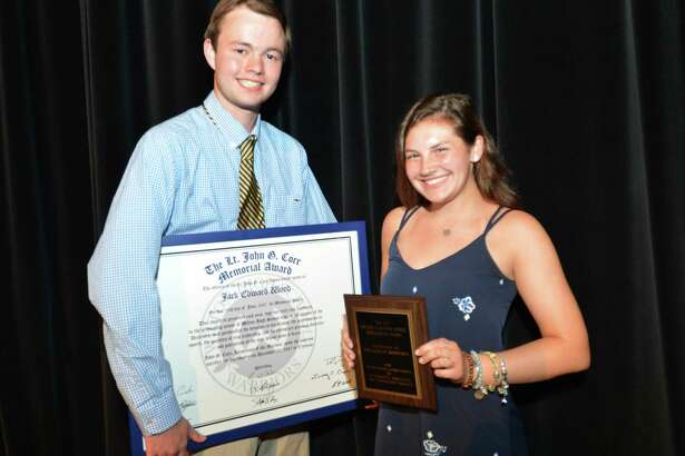 Jack Wood the recipient of the Lt. John G. Corr Memorial award and Meaghan Downey with the Melissa Nickel Award during the Wilton High School Sr. Athletics Awards night on Thursday June 15, 2017 in Wilton Conn.
