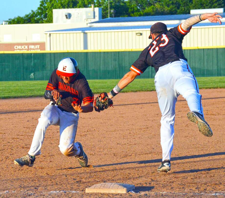 Edwardsville's Chase Gockel, left, avoids the tag of Rawlings third baseman Stephen Randazzo in the fifth inning of Thursday's game at Tom Pile Field.