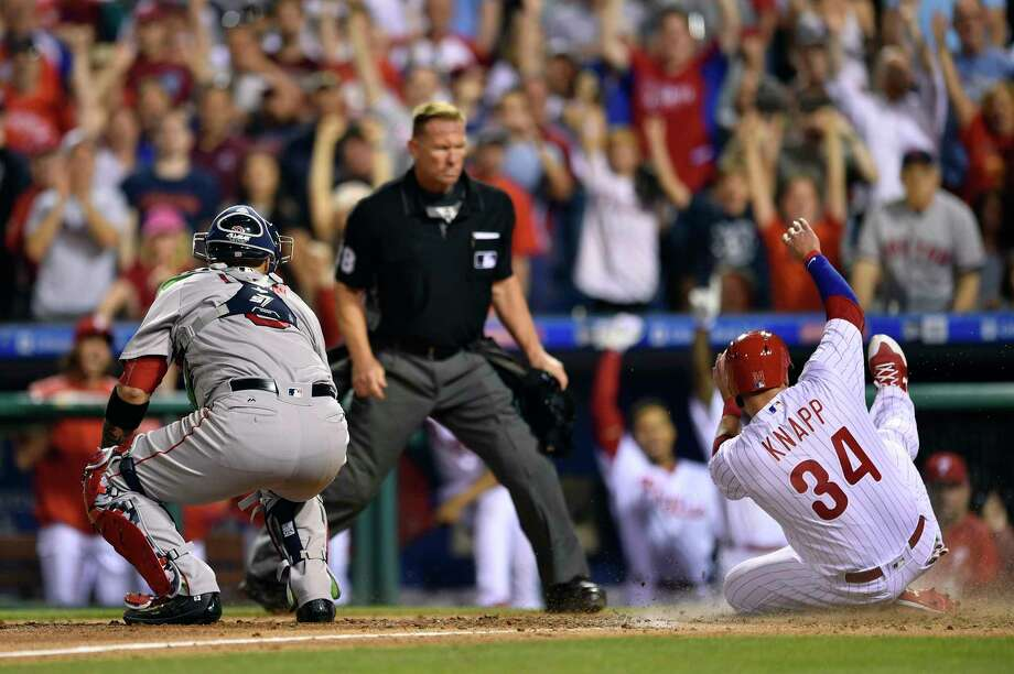 Philadelphia Phillies' Andrew Knapp, right, slides safely past Boston Red Sox catcher Sandy Leon on a double by Ty Kelly off Chris Sale during the eighth inning of a baseball game, Thursday, June 15, 2017, in Philadelphia. The Phillies won 1-0. (AP Photo/Derik Hamilton) ORG XMIT: PXS107 Photo: Derik Hamilton / FR170553 AP