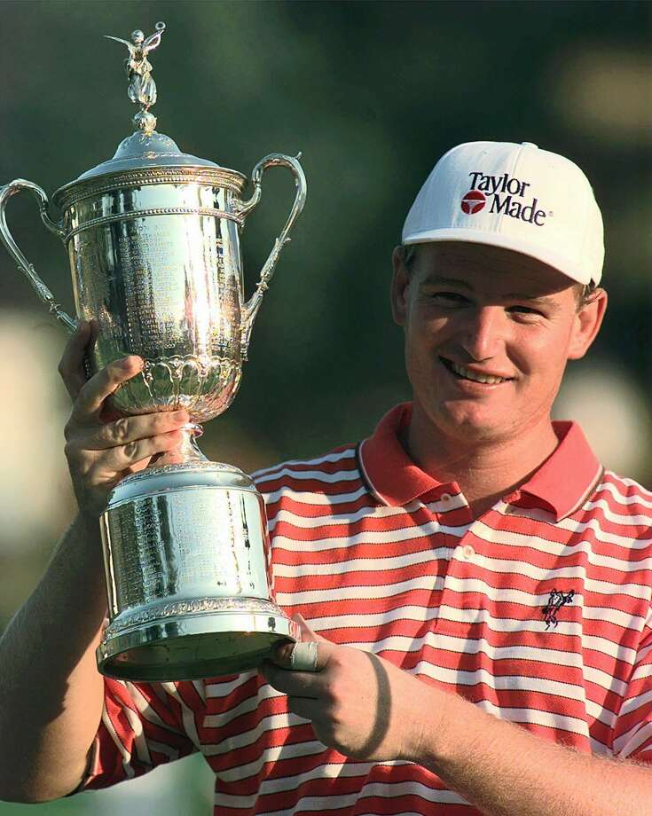 FILE - In this June 15, 1997, file photo, Ernie Els holds up the trophy after winning the U.S. Open golf tournament at Congressional Country Club in Bethesda, Md. In the first major since 21-year-old Tiger Woods won the Masters by 12 shots, Els was the first to step forward by winning at Congressional for his second U.S. Open title. (AP Photo/Doug Mills, File) ORG XMIT: NY161 Photo: DOUG MILLS / AP1997