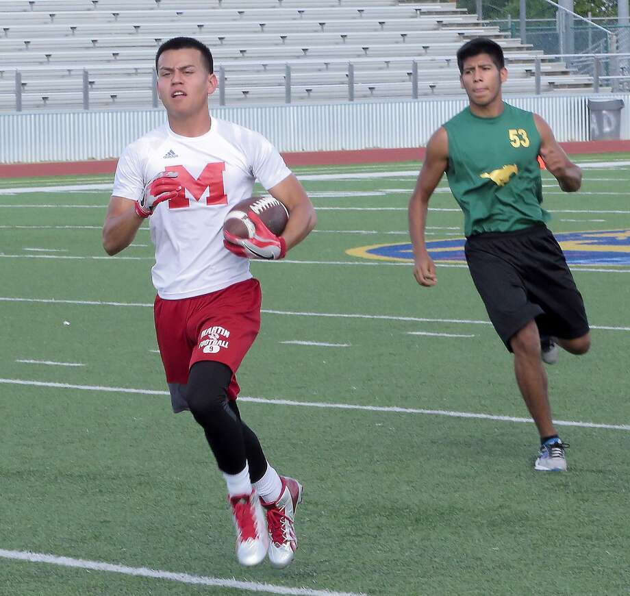 Martin's Angel Davila and the Tigers tied with Nixon 39-39 during Week 2 of summer league 7-on-7 football at Krueger Field. Photo: Cuate Santos /Laredo Morning Times / Laredo Morning Times
