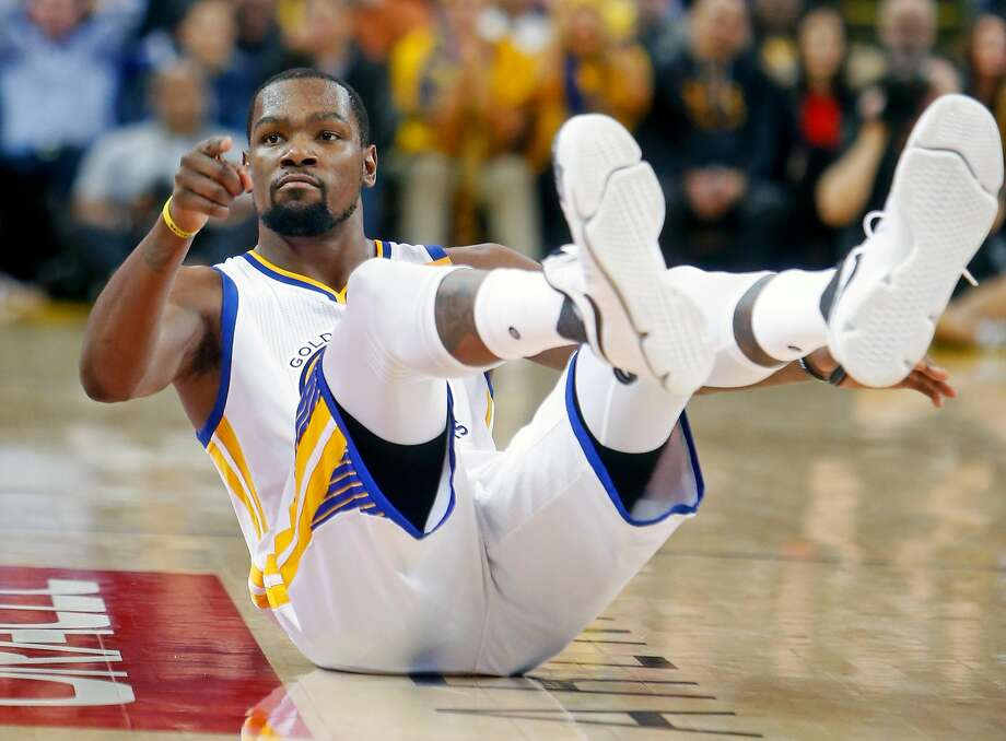 Golden State Warriors' Kevin Durant points to the bench after hitting a 2nd quarter 3-pointer while being fouled against Portland Trail Blazers during NBA game at Oracle Arena in Oakland, Calif., on Wednesday, January 4, 2017. Photo: Scott Strazzante, The Chronicle
