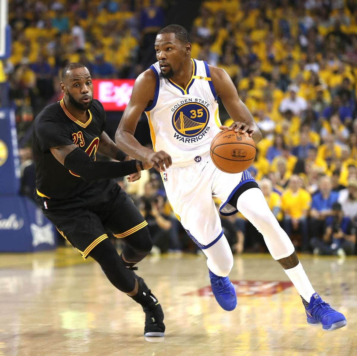 Golden State Warriors' Kevin Durant and Cleveland Cavaliers' LeBron James in 1st quarter of Game 2 of NBA Finals at Oracle Arena in Oakland, Calif., on Sunday, June 4, 2017.