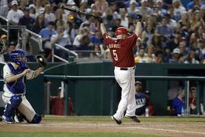 Rep. Kevin Brady, R-Texas, strikes out during the Congressional baseball game, Thursday, June 15, 2017, in Washington. The annual GOP-Democrats baseball game raises money for charity. The democrats won 11-2. (AP Photo/Alex Brandon)