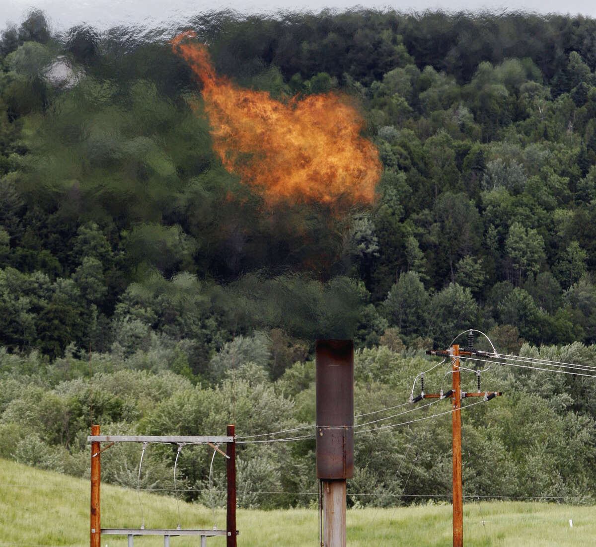 Methane burns at a landfill in Coventry, Vt. The Trump administration is delaying two Obama-era regulations aimed at restricting harmful methane emissions from oil and gas production.