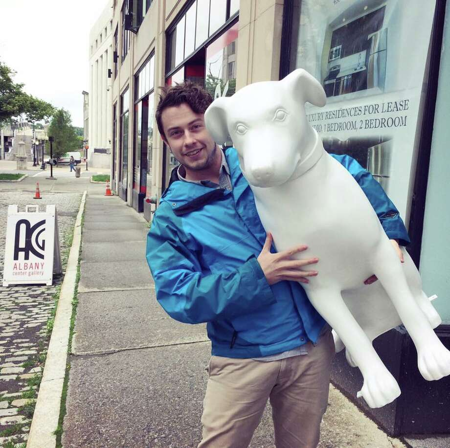 Artist Scotty M. Somerville of Loudonville picked up his Nipper and headed to his studio. Scotty was chosen as one of the 20 artists to paint a 3-foot tall sculpture of Albany?s famous canine resident Nipper for the Albany Downtown is Pawsome program. Somerville is a Siena College graduate employed by Creative Corks, Malta and Spa Fine Art, Saratoga, as well as the lead vocalist for The LateShift band. (Maureen Somerville)