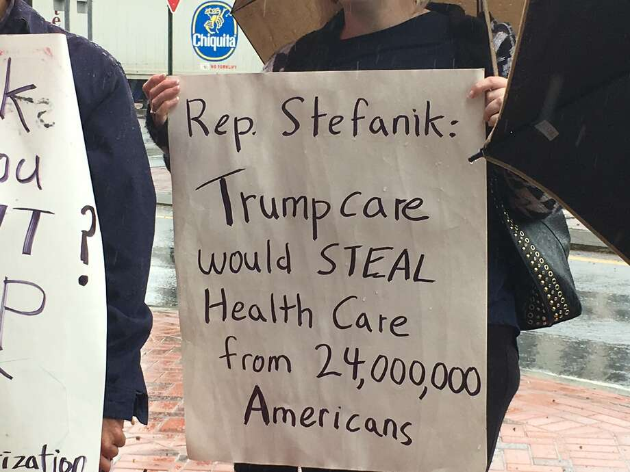 Protesters concerned over U.S. Rep. Elise Stefanik's support of the American Health Care Act rally at her Glens Falls office. (Wendy Liberatore / Times Union)