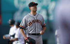 San Francisco Giants starting pitcher Matt Moore reacts after giving up an RBI double to Colorado Rockies' Nolan Arenado during the first inning of a baseball game Thursday, June 15, 2017, in Denver. (AP Photo/David Zalubowski)