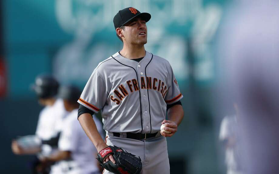 San Francisco Giants starting pitcher Matt Moore reacts after giving up an RBI double to Colorado Rockies' Nolan Arenado during the first inning of a baseball game Thursday, June 15, 2017, in Denver. (AP Photo/David Zalubowski) Photo: David Zalubowski, Associated Press
