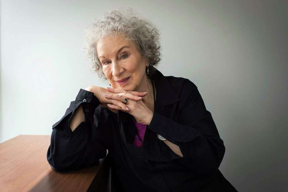 """FILE - In this July 28, 2016 file photo, author Margaret Atwood sits for a portrait while promoting her new books """"Angel Catbird"""" and """"Hag-Seed"""" in Toronto.  Atwood is receiving a lifetime achievement award from one of the world's oldest literary organizations.   PEN Center USA announced Wednesday, June 14, 2017,  that  Atwood will be recognized at an Oct. 27 ceremony at the Beverly Hilton Hotel. Actor and writer Nick Offerman is set to host the evening.(Aaron Vincent Elkaim/The Canadian Press via AP) ORG XMIT: NYDK501 Photo: Aaron Vincent Elkaim / The Canadian Press"""