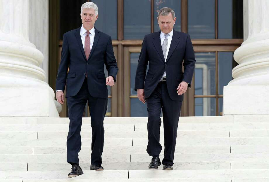 WASHINGTON, DC - JUNE 15:  Supreme Court Justice Neil Gorsuch (L) walks down the steps of the Supreme Court with Chief Justice John Roberts (R) following his official investiture at the Supreme Court June 15, 2017 in Washington, DC. Gorsuch has been an active member of the court since his confirmation though the official investiture ceremony was held today.  (Photo by Win McNamee/Getty Images) ORG XMIT: 700065487 Photo: Win McNamee / 2017 Getty Images