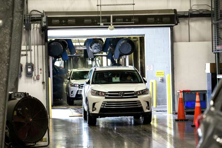 Vehicles are washed at Gulf States Toyota Vehicle Processing Center on Thursday, June 1, 2017, in Houston. ( Brett Coomer / Houston Chronicle )