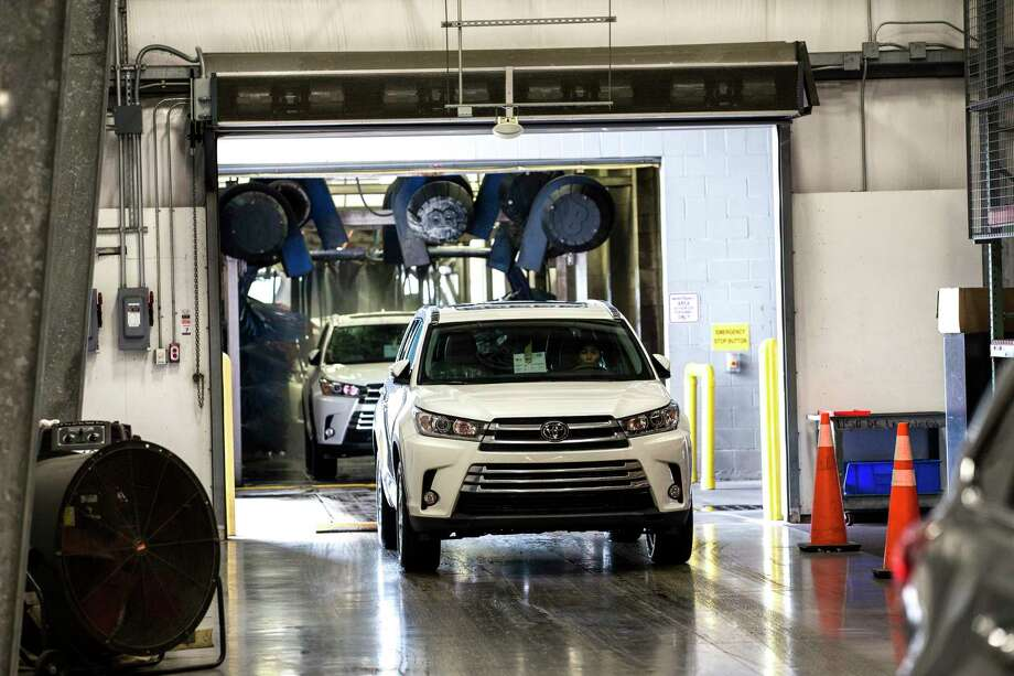 Vehicles are washed at Gulf States Toyota Vehicle Processing Center on Thursday, June 1, 2017, in Houston. ( Brett Coomer / Houston Chronicle ) Photo: Brett Coomer, Staff / © 2017 Houston Chronicle