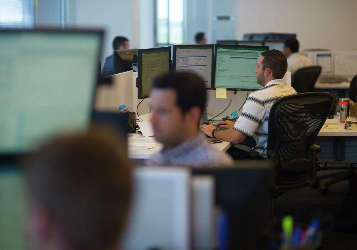 Energy traders work inside their office at Spark Energy, Thursday, May 25, 2017, in Houston. (Mark Mulligan / Houston Chronicle)