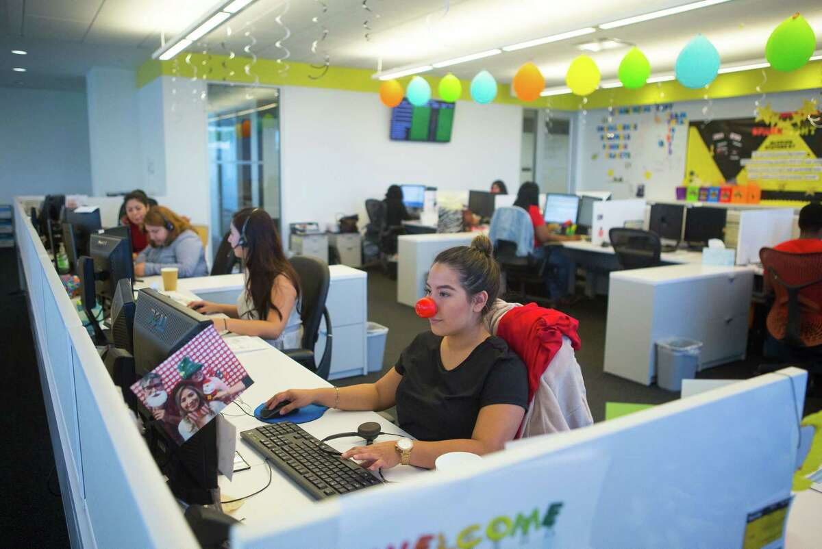 Call center staff make calls at the offices of Spark Energy, Thursday, May 25, 2017, in Houston. (Mark Mulligan / Houston Chronicle)