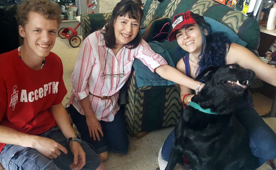 John LeBlanc, Kay Pass and Jae-Alise Monette pose with Lucky the dog at AABY Thrift Shop in Kingwood Wednesday, June 14. Photo: Melanie Feuk