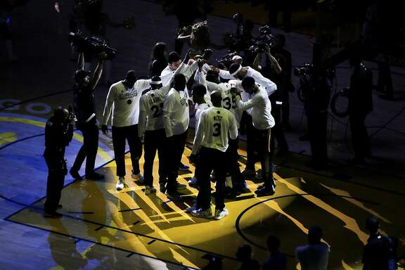 The Golden State Warriors huddle before the start of the first quarter of the NBA Finals Game 1 between the Golden State Warriors and the Cleveland Cavaliers on Thursday, June 1, 2017, at Oracle Arena in Oakland, Calif.