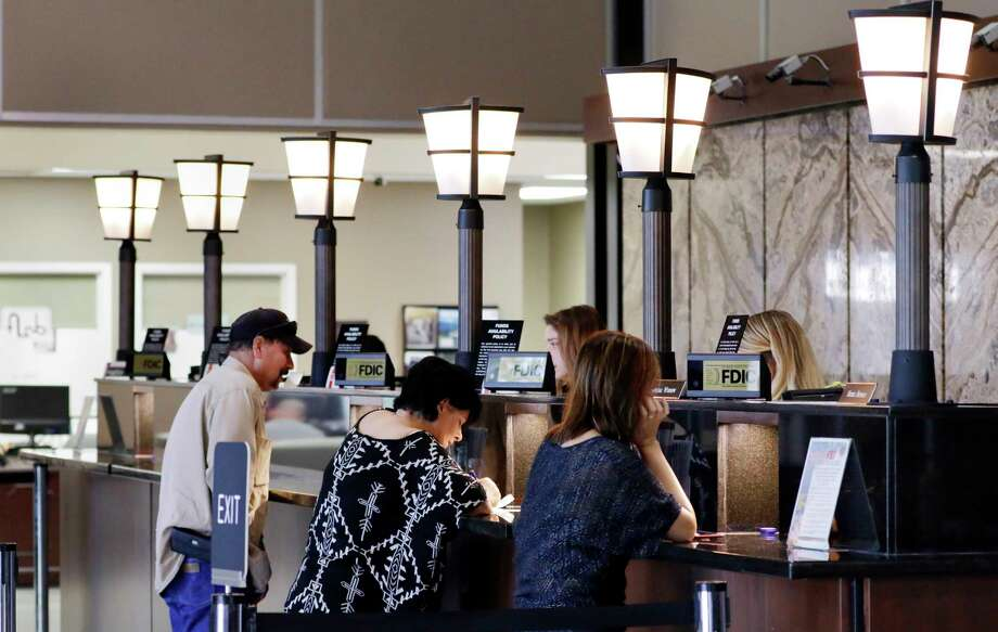 Customers at the teller windows at the First Liberty National Bank in Liberty, TX, June 2, 2017. (Michael Wyke / For the  Chronicle) Photo: Michael Wyke, Freelance / © 2017 Houston Chronicle