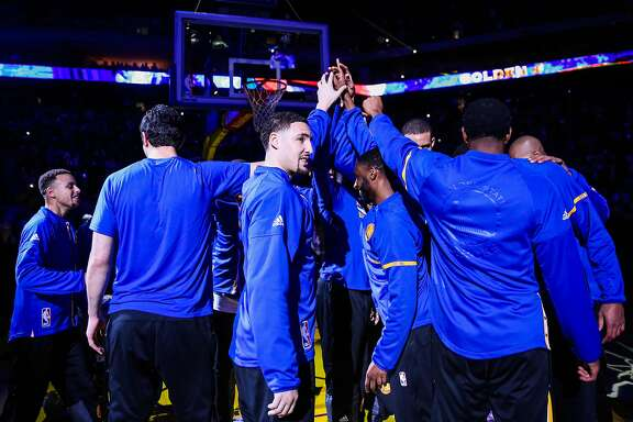 Golden State Warriors' Klay Thompson, #11 (center) cheers with his teammates ahead of a game against the Indiana Pacers, in Oakland, California, on Monday, Dec. 5, 2016.