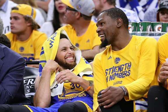Golden State Warriors' Stephen Curry and Kevin Durant enjoy final minutes of Warriors' 120-108 win over San Antonio Spurs in Game 3 of NBA Western Conference Finals at AT&T Center in San Antonio, Texas, on Saturday, May 20, 2017.