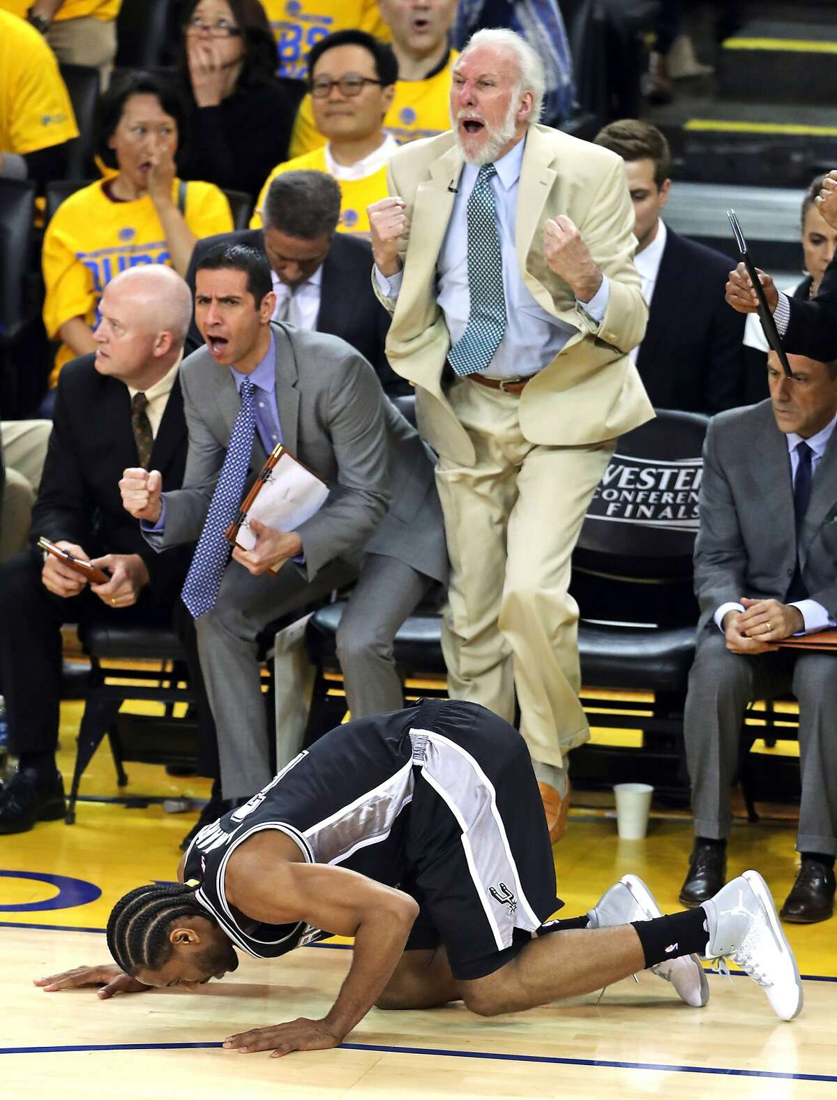 San Antonio Spurs' coach Gregg Popovich reacts to Kawhi Leonard re-injuring his ankle in 3rd quarter of Golden State Warriors' 113-111 win during Game 1 of NBA Western Conference Finals at Oracle Arena in Oakland, Calif., on Sunday, May 14, 2017.